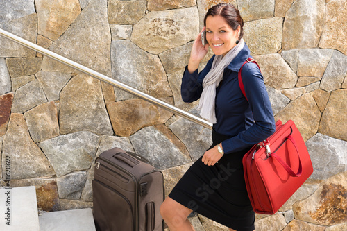 Fotografie, Obraz  Smiling woman talking phone business traveling rushing