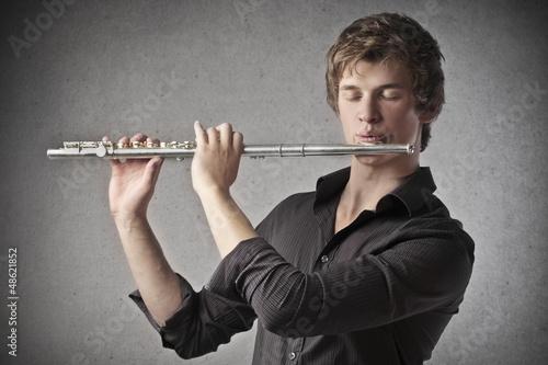 Photo boy playing flute