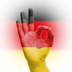 Naklejka hand OK sign with German flag