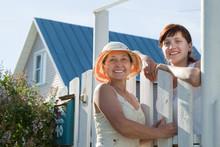 Two Happy Women Near Fence Wicket