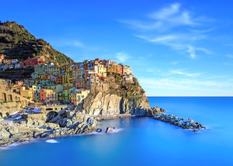 FototapetaManarola village, rocks and sea at sunset. Cinque Terre, Italy