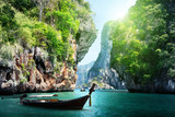 Fototapeta Natura - long boat and rocks on railay beach in Krabi, Thailand