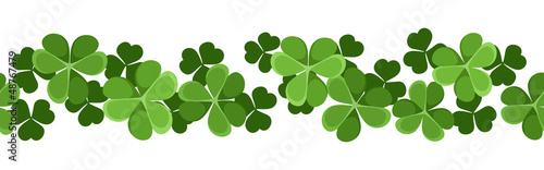 Fotografía  St. Patrick's day vector seamless background with shamrock.