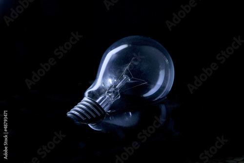 Fototapety, obrazy: light bulb floating on water with low key light effect in studio