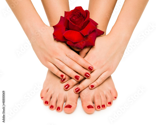 Foto op Plexiglas Pedicure manicure and pedicure shows girl with rose