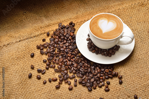 Latte art and coffee beans - 48812893