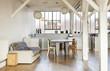 wide room of loft, beams and wooden floor