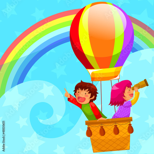 Deurstickers Regenboog kids flying in a hot air balloon