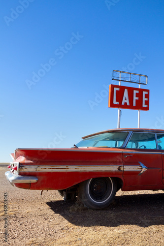 In de dag Route 66 Cafe Sign and Old Car on Route 66