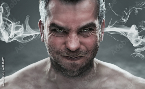 Close up of angry man with steam coming out from his ears Poster Mural XXL