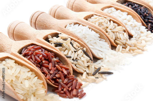 Fotografie, Obraz  Wooden scoops with different rice types scattered from them