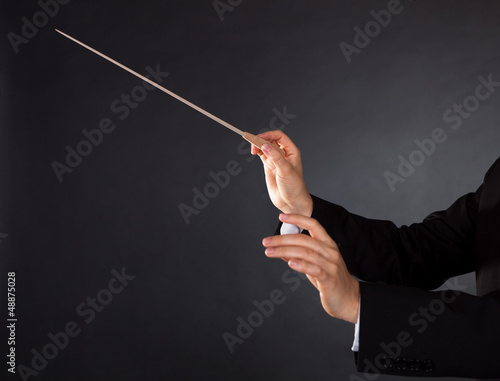 Photo  Music conductor with a baton