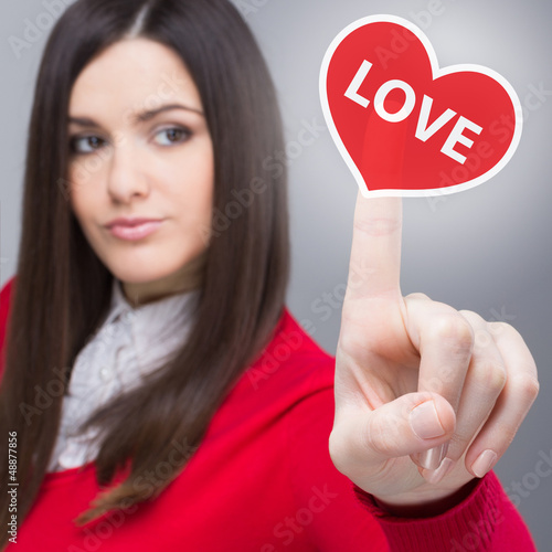 Young businesswoman clicking heart shaped button - Buy this