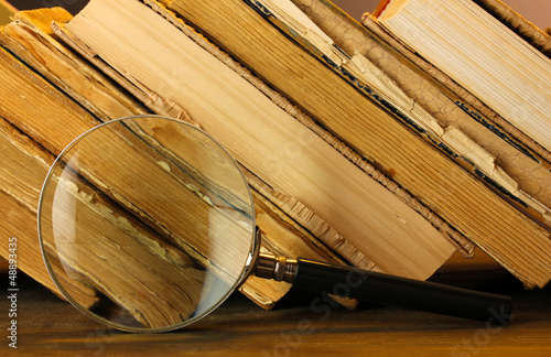Photo Stands Stairs Magnifying glass and books on table