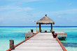 resort maldivian houses in blue sea