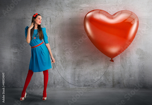 Woman holding a heart shaped balloon Poster