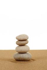 Fototapeta na wymiar Balance zen stones in sand on white