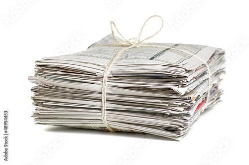 Fotografie, Obraz verschnürter Zeitungsstapel