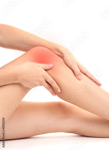 Poster Pedicure woman holding sore knee, isolated on white