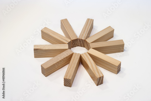 Wooden bricks in a star ring - Buy this stock photo and