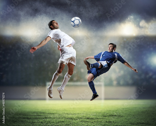 Tuinposter voetbal two football players striking the ball