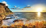 Zachód słońca na wybrzeżu Reunion. - 48976471