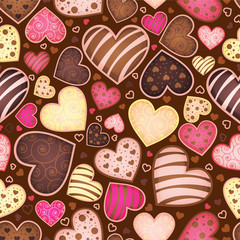 Fototapetaseamless chocolate pattern with sweetmeat in form heart