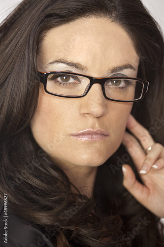 Fototapety, obrazy: CLOSEUP OF YOUNG BRUNETTE WOMAN IN GLASSES