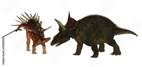 Photo  dicératops contre kentrosaurus