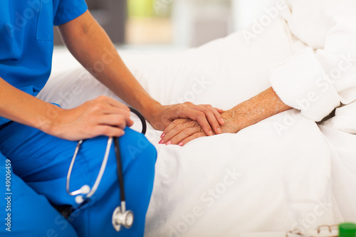 Stampa su Tela medical doctor holing senior patient's hands and comforting her