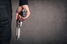 Killer With Gun Close Up Over ...