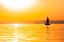 Sailing Boats With A Beautiful Sunset