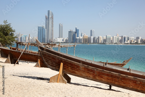 Traditional arabian boats on the beach of Abu Dhabi
