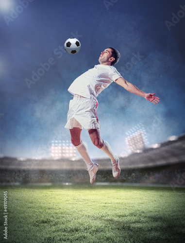Keuken foto achterwand Voetbal football player striking the ball