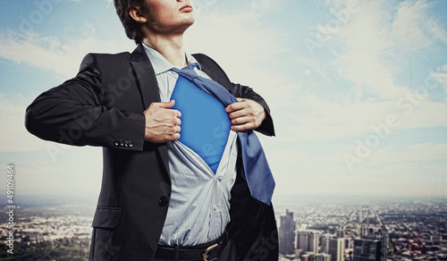 Fotografering  Young superhero businessman