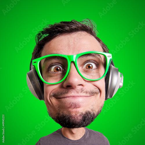 Valokuvatapetti puppet man listening to music with big head