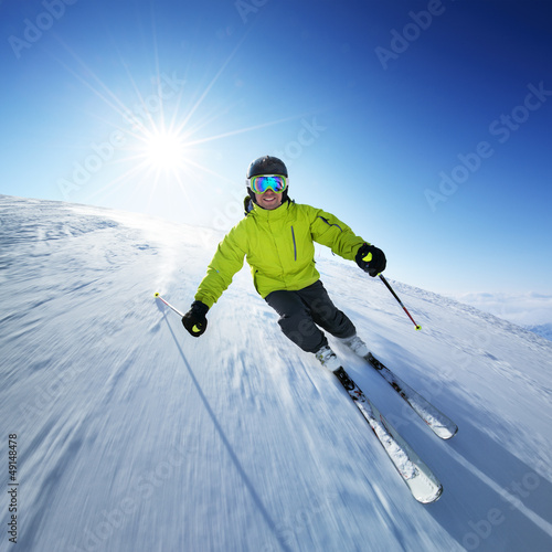 Wall Murals Winter sports Skier on piste in high mountains