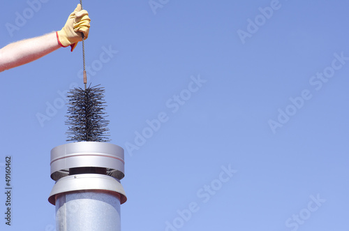 Stampa su Tela Cleaning chimney with sweeper sky background