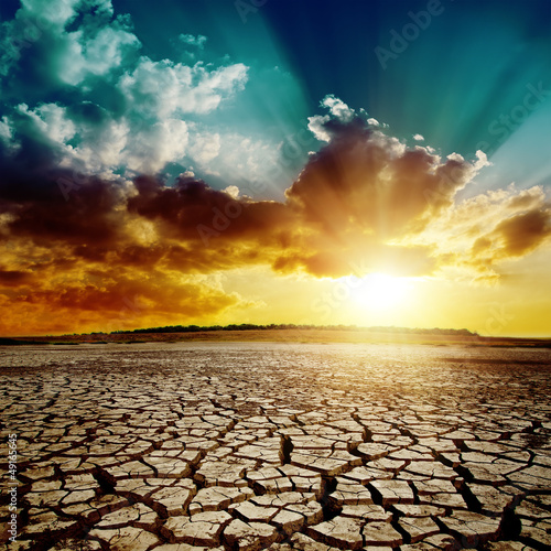 Stampa su Tela global warming. dramatic sunset over cracked earth