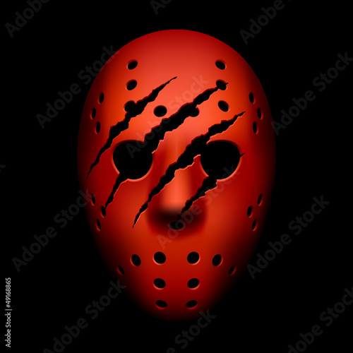 Photo  Red hockey mask with traces of claws