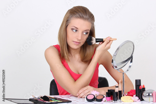 beautiful blonde with make up brushes and accessories