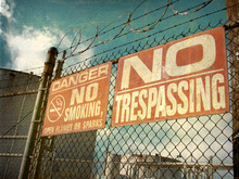 Aged No Trespassing Sign