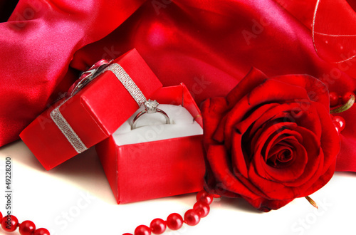 0a41c2598 Beautiful box with wedding ring and rose on red silk background ...