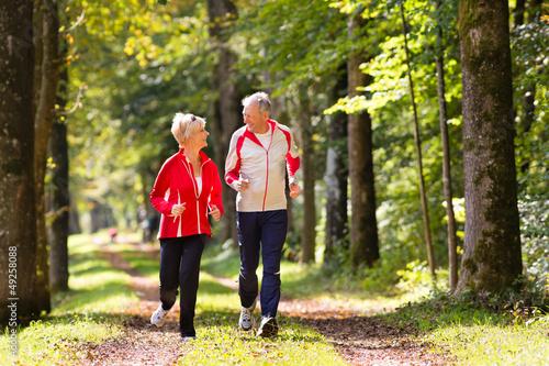 Papiers peints Jogging Seniors jogging on a forest road