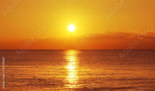 Spoed Foto op Canvas Zee zonsondergang Sunset and ocean