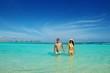asian couple enjoying summer on beach
