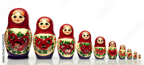 Fotografie, Obraz  Nested doll - a dreny national Russian doll of handwork.