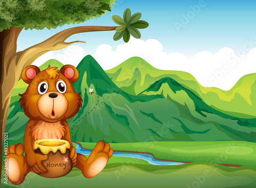Papiers peints Ours A bear in the riverbank