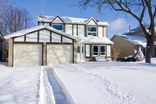 House And Driveway Covered Wit...