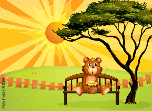 Wall Murals Bears A bear with a pot of honey sitting at the bench